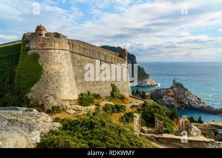 View of Castle Doria and Church of St. Peter in Portovenere or Porto Venere town on Ligurian coast. Province of La Spezia. Italy - Stock Photo