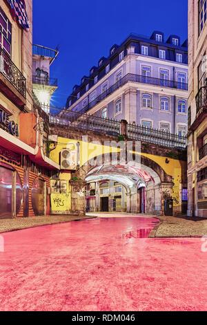 "Lisbon, Portugal - December 9, 2018: ""Pink Street"" pedestrian street of Rua Nova do Carvalho in the Cais do Sodré area of Lisbon during blue hour - Stock Photo"
