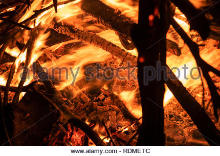 Firewood burning the concept of wood heating - Stock Photo