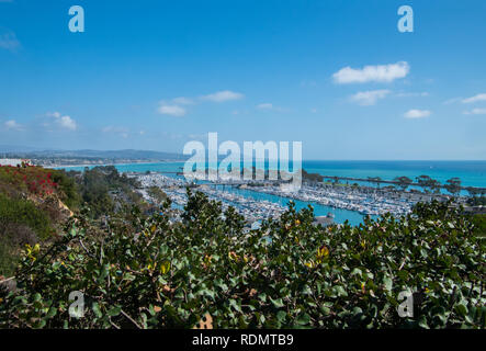 View of beautiful marina from above. There are bushes in the foreground - Stock Photo