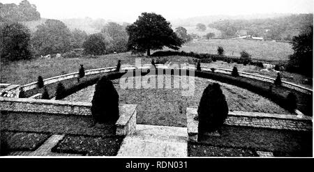 . Gardens for small country houses. Gardens. 84 On Hillside Gardens. Another interesting treatment of a hillside site is shown in the photograph and plan (Figs, no and in) of a garden at Steep, designed by Mr. Inigo Triggs. In the front of the house is a terrace twenty-five feet wide, with steps leading down to a semi-circular grass terrace bordered by yew hedges. The next lower level is occupied by two flower borders divided by a grass path. From the end of the latter another flight of steps leads down to a green walk, which is enclosed on each side by yew hedges. This slopes down to a round  - Stock Photo
