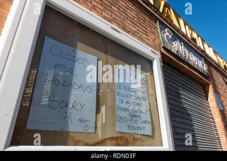 Wanna rent a midget, sign outside a nightclub in Benidorm, Costa Blanca, Spain - Stock Photo