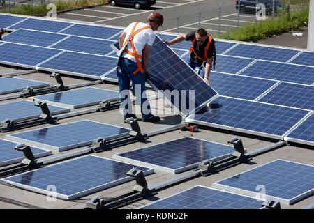 Construction of a large photovoltaic system on several rooftops, 16000 square metres, Gelsenkirchen, North Rhine-Westphalia - Stock Photo
