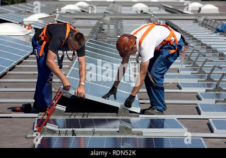 Construction of a large photovoltaic system, 16000 square metres, on several rooftops, Gelsenkirchen, North Rhine-Westphalia - Stock Photo