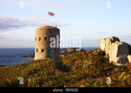 Martello towers, watch towers and fortified towers built in the 17th century, situated along the coastline, here number 5 at - Stock Photo