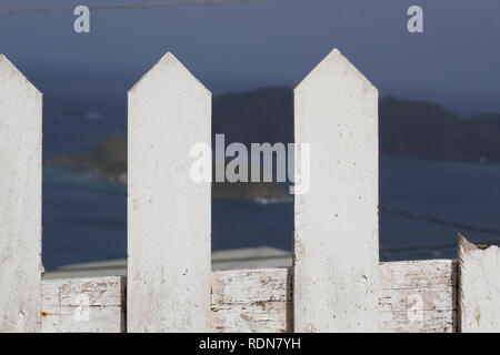 White Picket Fence Overlooking a Bay - Stock Photo