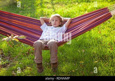 Little girl in a hammock - Stock Photo