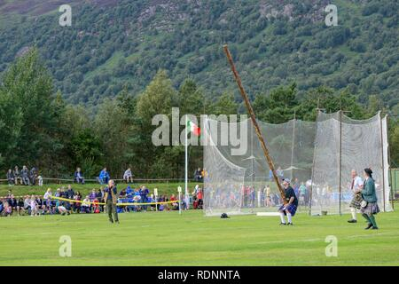 Tossing the caber, Highland Games, Newtonmore, Scotland, United Kingdom - Stock Photo