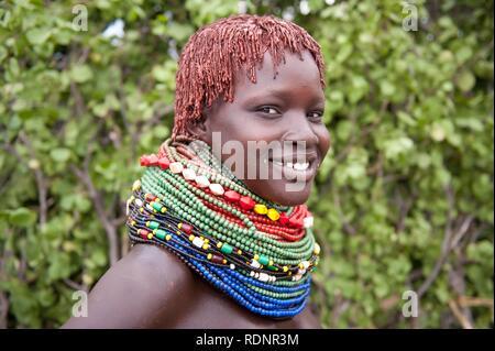 Nyangatom, Bume or Buma girl with bead necklaces, Omo Valley, Ethiopia, Africa - Stock Photo