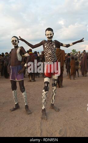 Young Nyangatom, Bumi, boys with painted face, Omo river Valley, Ethiopia, Africa - Stock Photo