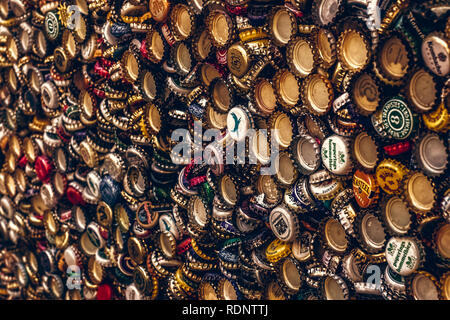 Background of beer bottle caps, a mix of various european brands - Stock Photo