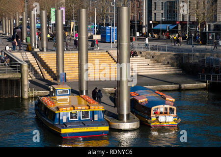 Bristol ferry boats wait at the Centre Landing jetty. The ferries ease city centre congestion by carrying commuters and tourists in the city centre. - Stock Photo