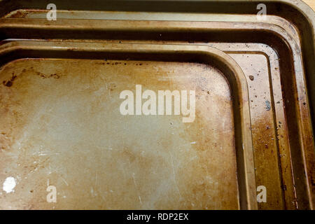 old stained baking trays - Stock Photo