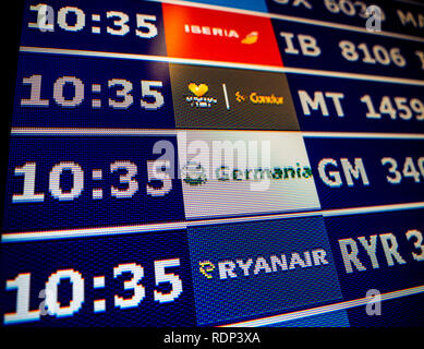 PALMA DE MALLORCA, SPAIN - MAY 11, 2018: Close-up details of a typical airport information board with mutiple airlines hours departure gates and insignia for the boarding gate Ryanair Germania Condor Iberia  - Stock Photo