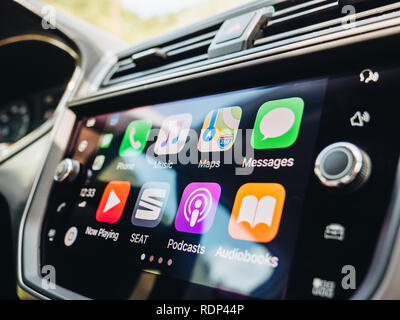 PALMA DE MALLORCA, SPAIN - MAY 10, 2018: Side view of large dashboard computer screen with apps buttons on the Apple CarPlay main screen in modern car dashboard  - Stock Photo