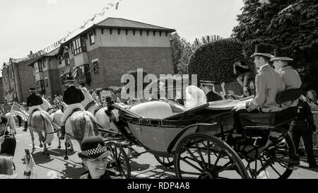WINDSOR, ENGLAND - MAY 19 2018: Prince Harry, Duke of Sussex and Meghan, Duchess of Sussex leave Windsor Castle in Ascot Landau carriage during a procession after getting married at St Georges Chapel - Stock Photo