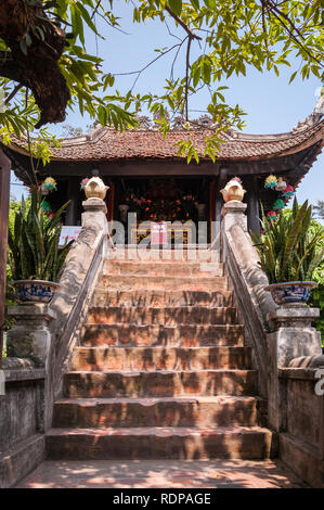 Stone steps leading to the shrine at One Pillar Pagoda on a sunny day, Hanoi, Vietnam - Stock Photo