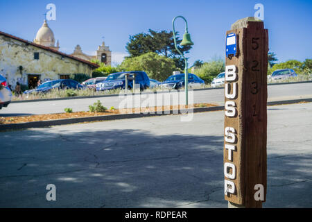 Bus stop on Junipero Serra; Carmel Mission in the background, Carmel-by-the-Sea, Monterey Peninsula, California - Stock Photo