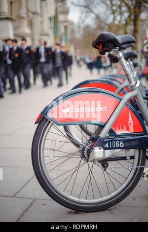 Santander 'Boris bikes' for hire on Cromwell Road in South Kensington, outside the V&A Museum - Stock Photo