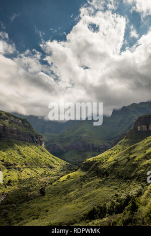 Ciffs and mountain sides under dramatic skies on the Thukela hike to the bottom of the Amphitheatre's Tugela Falls in the Royal Natal National Park, D - Stock Photo