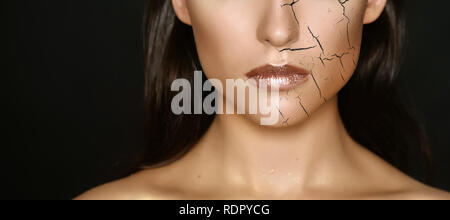 Woman with cracked on face as cosmetic and dehydration effect concept. - Stock Photo
