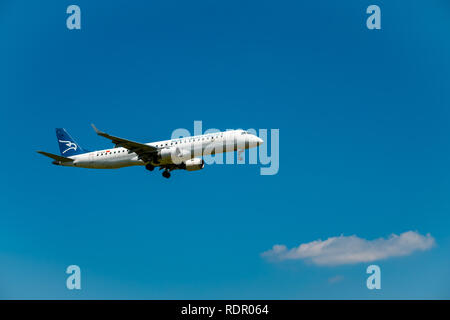 Montenegro airlines airplane preparing for landing at day time in international airport - Stock Photo