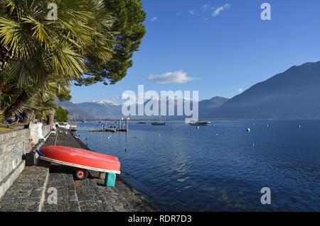 Small boat at the lakeside of Lake Maggiore, Locarno, Switzerland - Stock Photo