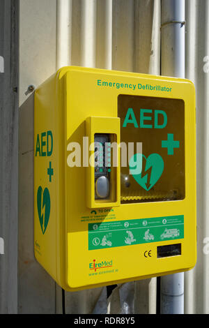 A public access defibrillator mounted on outside of village hall in Garlieston, Wigtownshire, Scotland, UK - Stock Photo