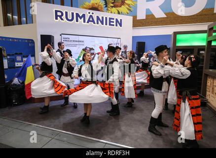 Berlin, Germany. 18th Jan, 2019. Staff members dance at the booth of Romania during the International Green Week (IGW) Berlin in Berlin, capital of Germany, on Jan. 18, 2019. The IGW Berlin, an international exhibition of the food, agriculture and gardening industries, opened on Friday and will last until Jan. 27, attracting more than 1,700 exhibitors from all over the world. Credit: Shan Yuqi/Xinhua/Alamy Live News - Stock Photo