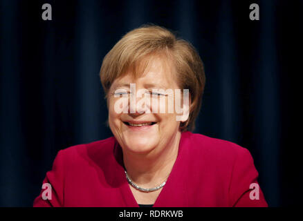Rostock, Germany. 19th Jan, 2019. Chancellor Angela Merkel (CDU) smiles on the podium at the state party conference of the CDU Mecklenburg-Western Pomerania. The CDU Mecklenburg-Western Pomerania will meet in the city hall for their 34th state party conference. Credit: Danny Gohlke/dpa/Alamy Live News - Stock Photo