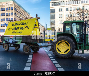 Berlin, Gemany, 19 January 2019. Farmers protest against the EU farm subsidies in Germany. A Parade of tractors  drove past the European Commission building in Unter den Linden as they took part in the protest march against current agricultural policy. Activists protest that large farming enterprises are favoured over smaller farms that support environmentally friendly methods. credit: Eden Breitz/Alamy Live News Credit: Eden Breitz/Alamy Live News - Stock Photo