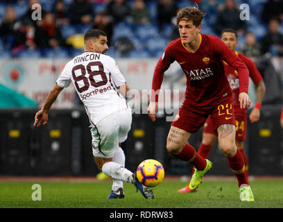 Rome, Italy, 19th January, 2019. Roma's Nicolo' Zaniolo, right, is challenged by Torino's Tomas Rincon during the Serie A soccer match between Roma and Torino at the Olympic Stadium. Roma won 3-2. © Riccardo De Luca UPDATE IMAGES/ Alamy Live News - Stock Photo