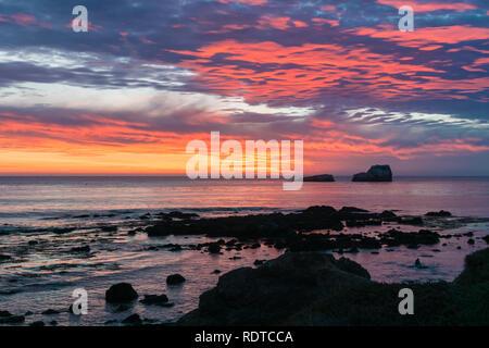Dramatic sunset on the Pacific Ocean coastline near San Simeon, California - Stock Photo