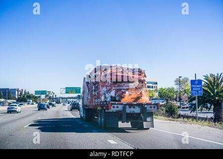 Truck carrying crushed car bodies for recycling, San Francisco bay area, California - Stock Photo