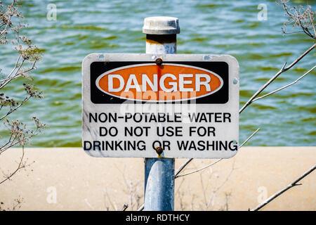 'Danger Non-potable water' sign posted on the shorelines of south San Francisco bay area, California - Stock Photo