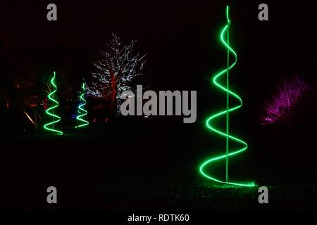 3 green neon Christmas trees at Christmas at Kew Gardens 2018 - Stock Photo