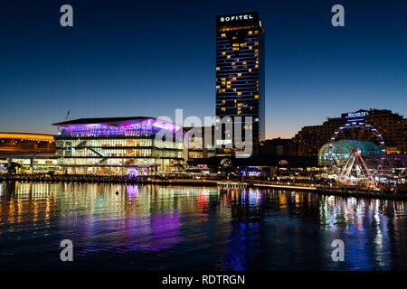 23rd December 2018, Sydney Australia: Night view of Darling Harbour with Sofitel hotel and the International Convention Centre in Sydney NSW Australia - Stock Photo