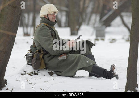 Saint Petersburg, Russia - February 23, 2017: Frozen german soldier of the Wehrmacht  on duty. Historical reenactment of Second World War. - Stock Photo