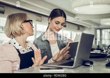Young waitress coming to job interview with owner of cafe - Stock Photo