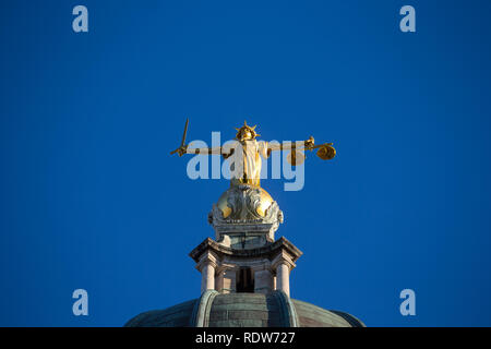 Lady Justice statue on top of The Old Bailey, Central Criminal Court, London, England. - Stock Photo
