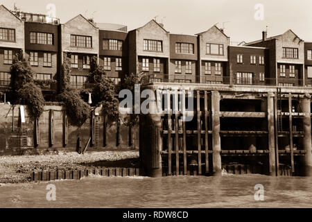 Sepia toned picture of an apartment building at the Thames River Docklands in London, United Kingdom - Stock Photo