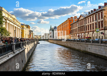 St. Petersburg, Russia - September 10 2018: Tourists crowd the square of the Spilled Blood Cathedral next to Griboyedov Channel off the Moyka River - Stock Photo
