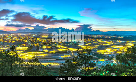 City night scene of a valley in Da Lat with greenhouses to plant flowers and vegetables. Blue hour moments when the sun sets it's time to light valley - Stock Photo