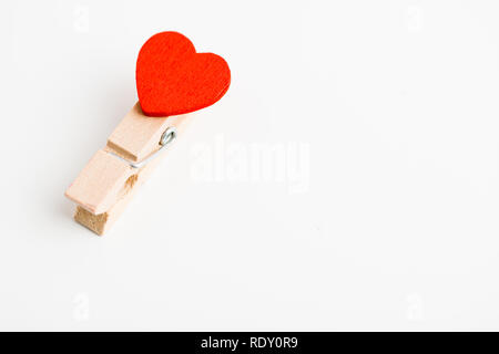 Single cloth pin with heart. Space for text. - Stock Photo