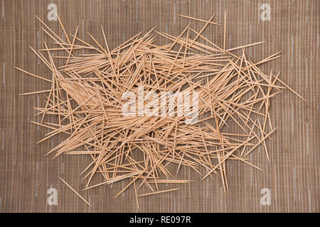mess of bamboo toothpicks for the dental care and teeth cleaning - Stock Photo