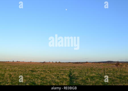 Featureless Cliffe marsh, north Kent, on a clear, cold winter late afternoon in January 2019. A bird reserve by the River Thames on Hoo peninsula - Stock Photo
