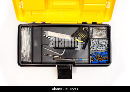 Top view of opened plastic box with mix of tools and instruments isolated on white background - Stock Photo