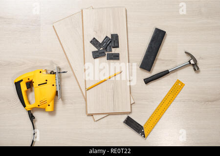 Top view of arranged wood cutting instrument with planks on wooden background - Stock Photo