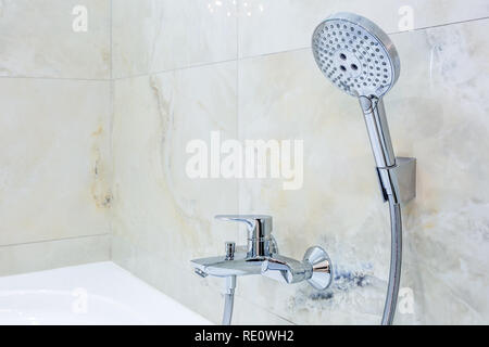 detail of a corner shower cabin with wall mount shower attachment - Stock Photo