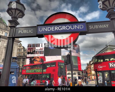 Piccadilly circus underground station entrance with Double decker red bus in the background - London - UK - Stock Photo